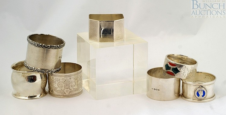 7 sterling silver napkin rings, Tiffany, UK Navy, London, 1897, other mostly English, very crisp condition, 8.44 TO