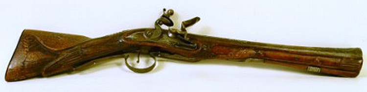 "CONTINENTAL CARVED AND SILVER WIRE INLAID BLUNDERBUSS FLINTLOCK. Raised silvered work on barrel and butt plate, trigger guard and lock plate. 21 1/2""l. (Note: barrel attached but loose and small area of inlay loose)."