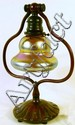 TIFFANY STUDIOS BRONZE DESK LAMP. #419. With glass shade signed L.C.T. With