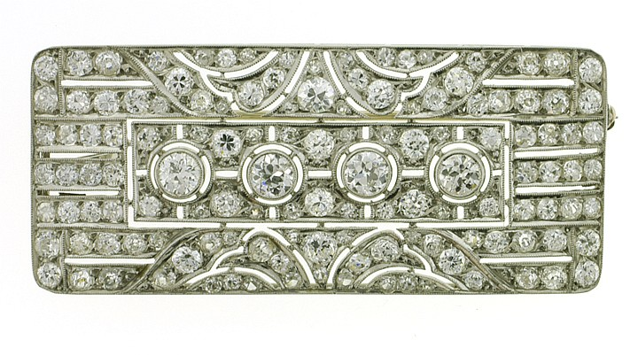 "PLATINUM ""ART DECO"" DIAMOND ENCRUSTED BROOCH. This"