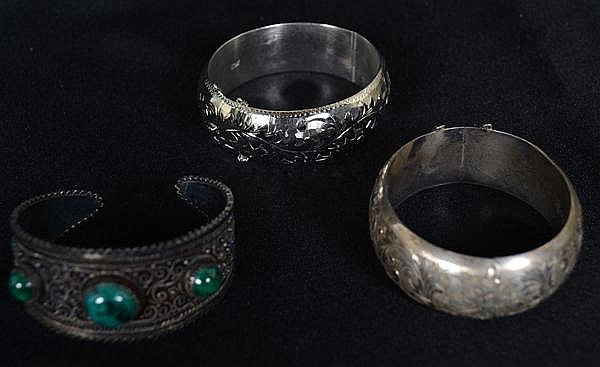 THREE STERLING BRACELEts. Includes: (2) Bright cut bangle bracelets and (1) Israeli cuff bracelet with glass cabochons. Weight: 3.7 troy ounces.