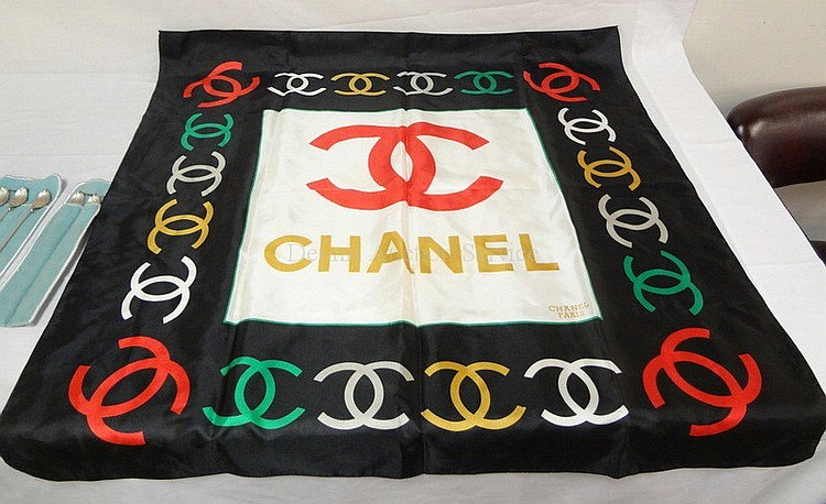 CHANEL, PARIS SILK SCARF; 34 1/2 IN X 33 1/4 IN