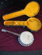 Four String Banjo in Case