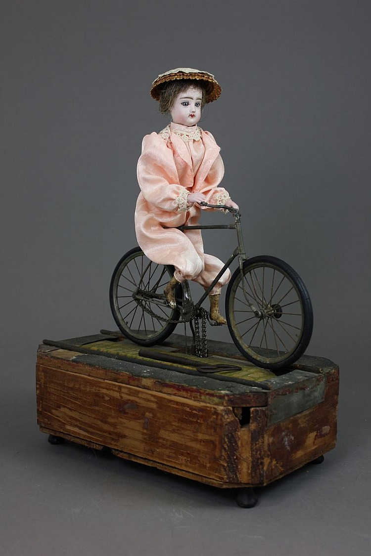 MECHANICAL GIRL ON BICYCLE