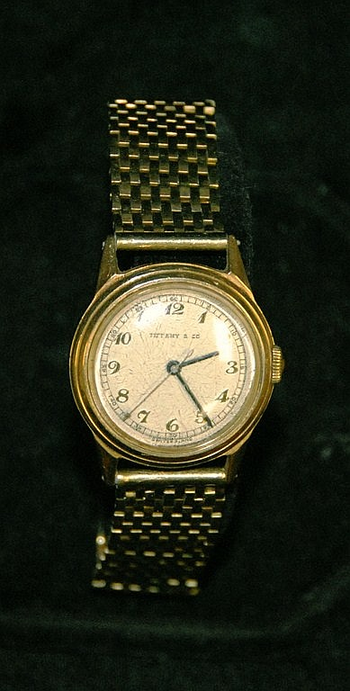 Tiffany & Co. 14K gold man's wristwatch with 14K gold mesh band marked with monogram. 64 grams total weight.
