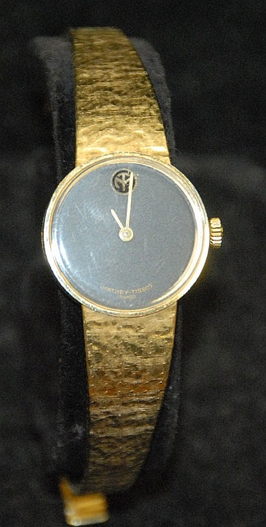 14K gold Mathey Tissot lady's wristwatch, stamped on band 585 Swiss Made. Total weight 35.2 grams