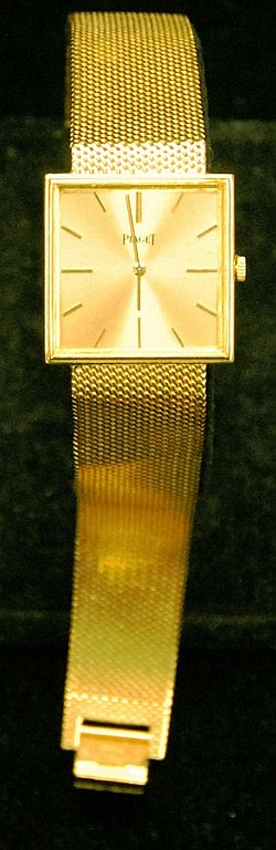 18K gold Piaget man's wristwatch with square face and mesh 18K gold band stamped 750 Piaget Modele Depose and inscribed on back. Pro..