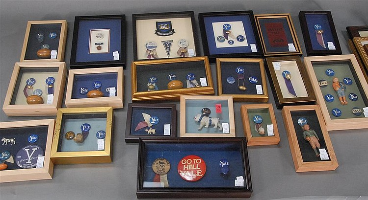 "Nineteen piece framed lot of Yale memorabilia; mostly pins some footballs and pins, frame sizes: 5 1/2"" x 4"" - 10"" x 10""."