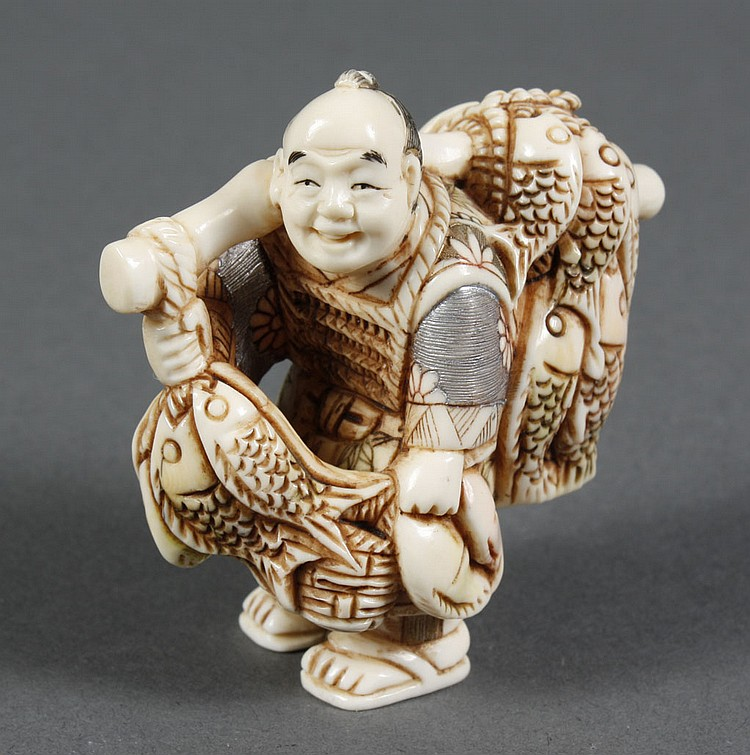 "CARVED IVORY NETSUKE - Fish vendor with fish on either end of shoulder pole; polychrome detail. Condition excellent. 2""H."