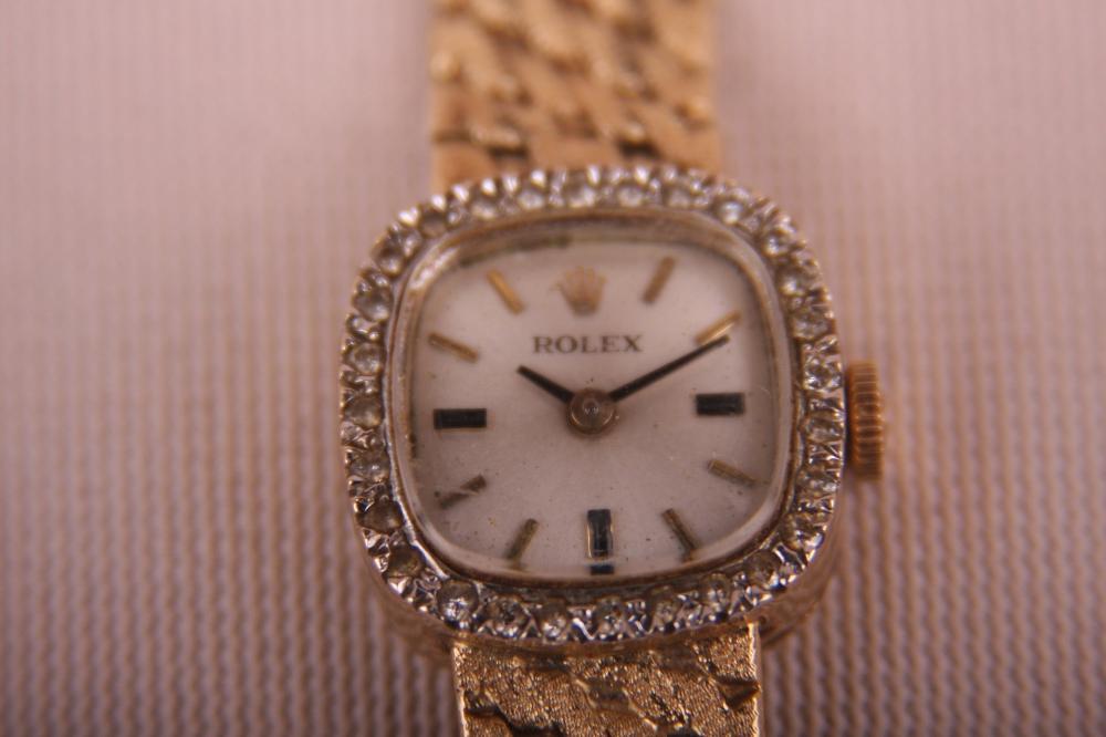 ROLEX LADIES 14K GOLD AND DIAMOND WRIST WATCH