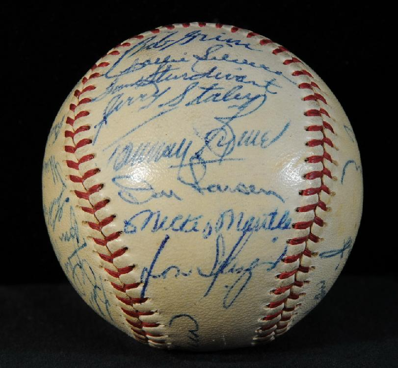 1956 NY Yankees World Series ball signed by entire team with 26 signatures on Official American League Ball including Mickey mantle, Yogi Berra, Whitey Ford, Don Larsen and more with Certificate of Authenticity by JSA
