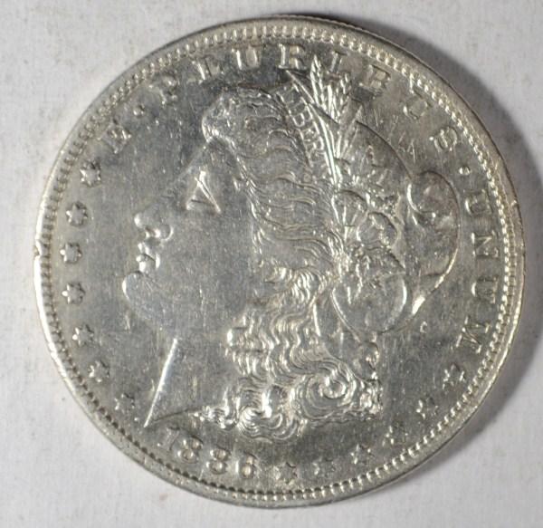 1886 S MORGAN DOLLAR AU