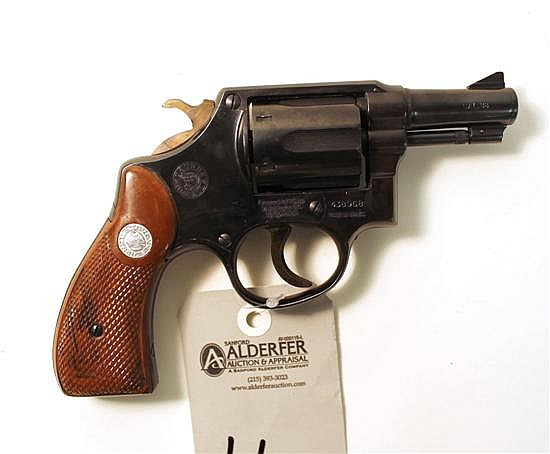 "Taurus double action revolver. Cal. 38 Spcl. 2-1/2"" bbl. SN 438968. Blued finish on metal, diamond checkered brown plastic grips sho..."