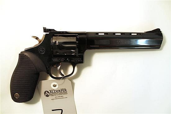 "Taurus Model 970 Tracker double action revolver. Cal. 22 LR. 6-1/2"" vent rib bbl. SN YH332514. Blued finish on metal, rubber grips, ..."