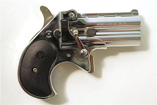 "Davis Industries Model D38 double barrel derringer. Cal. 38. 2"" bbl. SN D038523. Chrome finish on metal, black plastic grips show li..."