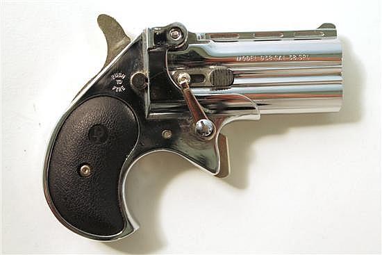 "Davis Industries Model D38 double barrel derringer. Cal. 38. 2"" bbl. SN D038523. Chrome finish on metal, black plastic grips show li..."