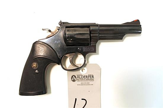 """Smith & Wesson Model 19-5 Combat Magnum double action revolver. Cal. 357 Mag. 4"""" bbl. SN ABL9078. Blued finish on metal, after marke..."""