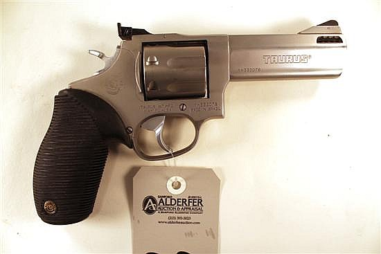 "Taurus 627 Tracker double action revolver. Cal. 357 Mag. 4"" ported bbl. SN YH332078. Stainless steel finish no metal, rubber factory..."