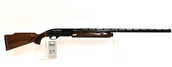 "Remington Model 1100 Trap semi-automatic shotgun. 12 ga. 30"" vent rib bbl. 2-3/4"" chamber. Full choke. SN M241545V. Blued finish on..."