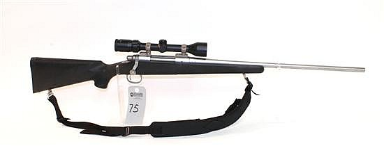 "Remington Model 700 bolt action rifle. Cal. 270 Win. 24"" bbl. SN S6227341. Stainless steel finish on metal, polymer stock shows mino..."
