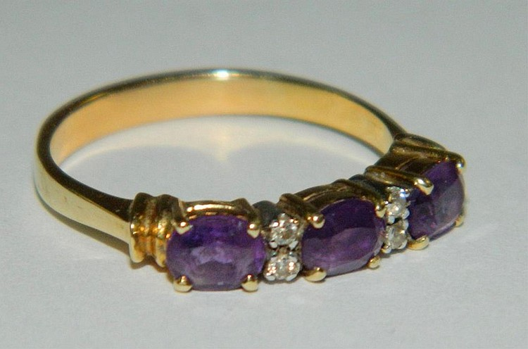 14k gold ring with diamonds and amethysts
