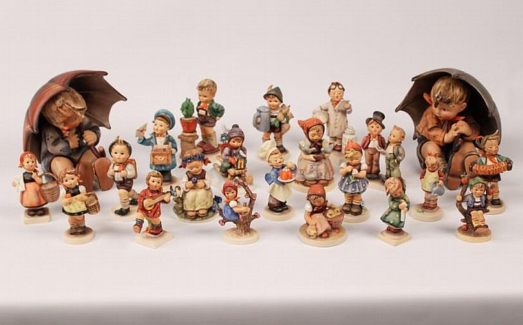 COLLECTION OF 22 HUMMEL FIGURINES
