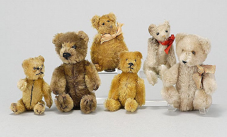"SIX SMALL STUFFED BEARS 1) Perfume holder (head comes off to reveal a glass bottle inside) in brown mohair. Fully jointed. Height 5""..."