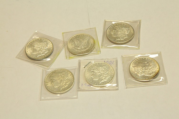 SIX MORGAN DOLLARS.