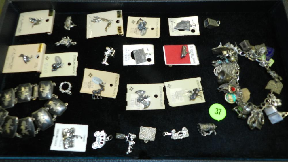 tray of all sterling jewelry including heavy charm bracelet, all other jewelry are charms (no tray)