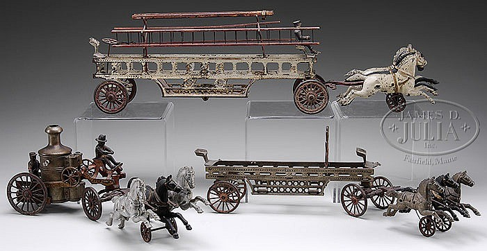 LOT OF 3 CAST IRON HORSE DRAWN FIRE TOYS.