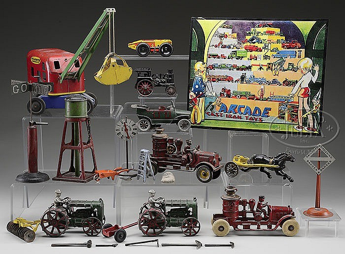 ASSORTED GROUP OF TIN AND IRON TOYS.