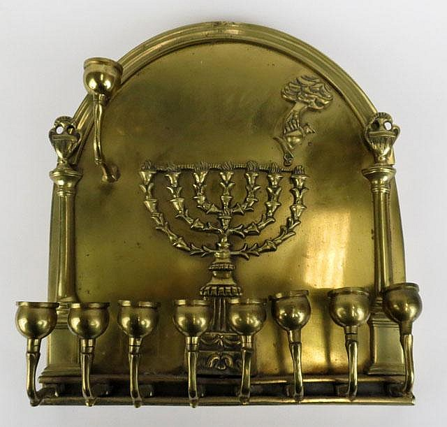 Unusual 20th Century or Earlier Brass Wall Hung Menorah. Unsigned. Three Candleholders Slightly Bent Otherwise Good Condition. Measures 11-1/2 Inches Tall and 10-1/2 Inches Wide. Shipping $68.00