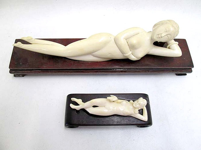 TWO IVORY CARVED DOCTOR'S LADIES with wooden