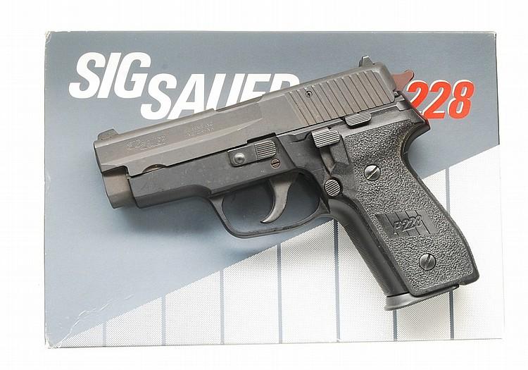 Sig Sauer P 228 Semi Auto Pistol.
